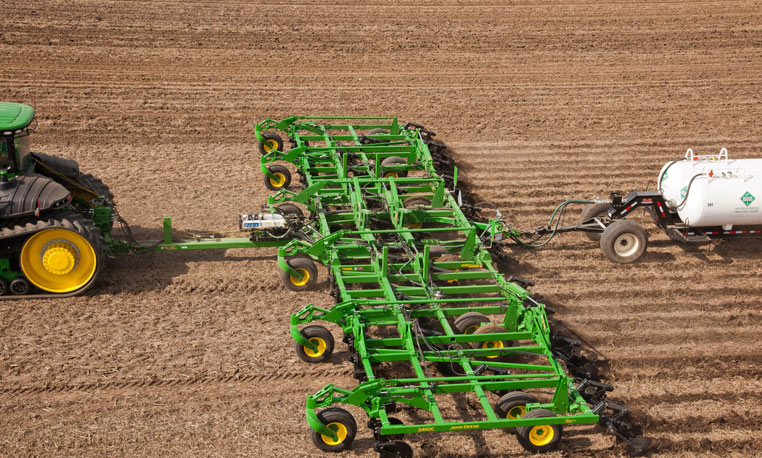 Overhead view of a John Deere nutrient application system at work in a ...